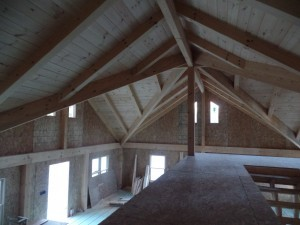 dramatic post and beam ceiling from loft, two-story home, post and beam house, laminated logs, heavy timbers, Timberhaven, log homes, log cabin kits, kiln dried