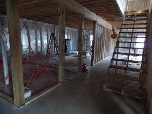 stairs to basement and interior wall framing, two-story home, post and beam house, laminated logs, heavy timbers, Timberhaven, log homes, log cabin kits, kiln dried