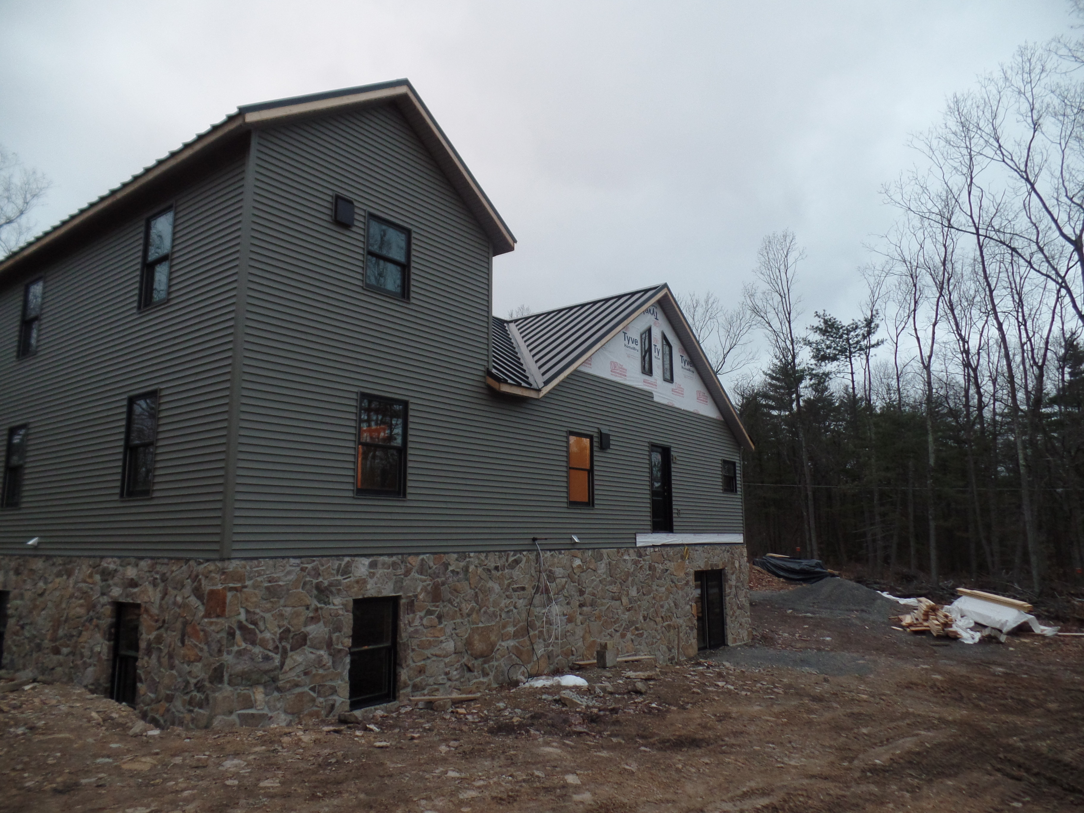 Custom post and beam home under construction part 12 for Custom stone homes