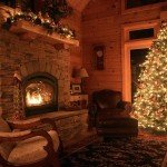 roaring fire in holiday themed log home, timberhaven log homes, log homes, log cabin kits, log cabins, Merry Christmas, stone fireplace