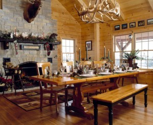 dining room table in holiday themed log home, timberhaven log homes, log homes, log cabin kits, log cabins, Merry Christmas, stone fireplace, fireplace in dining room, natural light, white pine