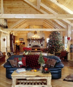 great room in holiday themed log home, timberhaven log homes, log homes, log cabin kits, log cabins, Merry Christmas, stone fireplace