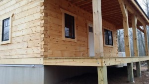 front porch of small log cabin, log cabin, log cabin homes, log homes, log cabin kits, Timberhaven, under construction, post and beam, laminated, kiln dried, PA manufacturer