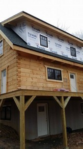 housewrap on shed dormer of log cabin home, log cabin, log cabin homes, log homes, log cabin kits, Timberhaven, under construction, post and beam, laminated, kiln dried, PA manufacturer