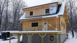 board & batten being installed to shed dormer, log cabin, log cabin homes, log homes, log cabin kits, Timberhaven, under construction, post and beam, laminated, kiln dried, PA manufacturer