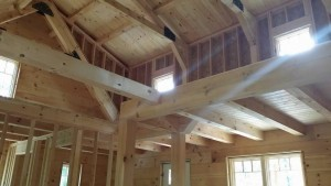 wide open living area and second floor loft, log cabin, log homes, log cabin homes, Timberhaven, under construction, laminated, kiln dried, Pennsylvania manufacturer