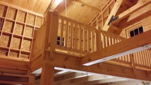 white pine railing on 2nd floor loft, log cabin, log homes, log cabin homes, Timberhaven, under construction, laminated, kiln dried, Pennsylvania manufacturer