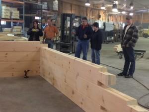 group looking at laminated log assembly, laminated logs, kiln dried, quality, Timberhaven, log homes, log cabins, log cabin kits, Pennsylvania log homes