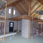 wide open living area and loft, post and beam, custom home, log homes, log cabins, log cabin kits, Timberhaven, laminated, kiln dried, under construction, PA log home manufacture