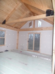 master bedroom with vaulted ceiling and private balcony, post and beam, custom home, log homes, log cabins, log cabin kits, Timberhaven, laminated, kiln dried, under construction, PA log home producer, dry wall installation