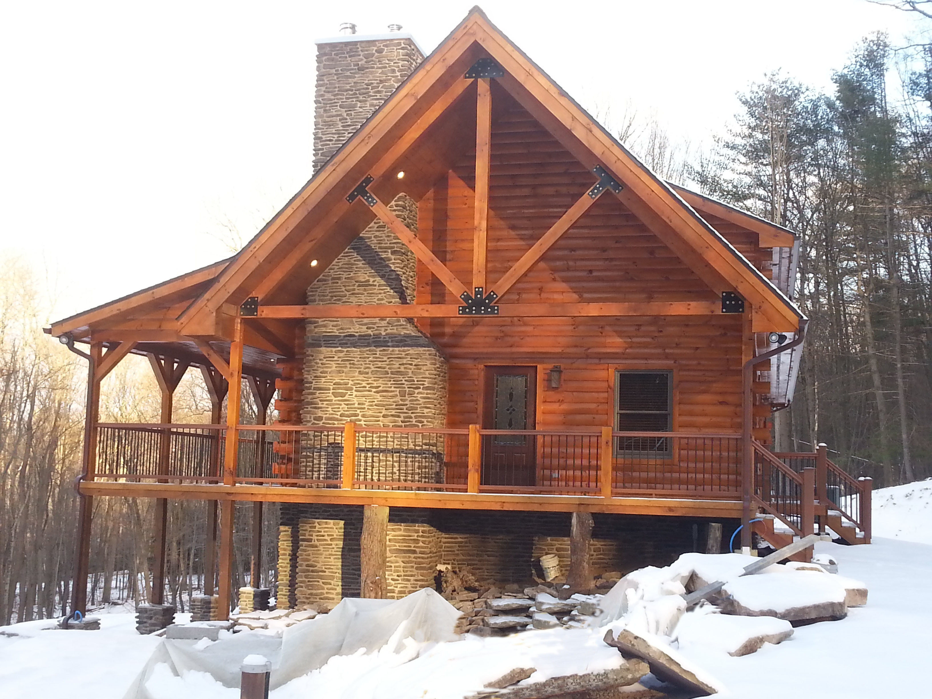 modified Valley View with King Post Truss and massive stone fireplace, Timberhaven Log Homes, Valley View, floor plan ideas, complete customization, laminated logs, engineered logs, kiln dried logs, design services, Pennsylvania, log homes, log cabins, log cabin kits, log cabin homes, log home packages