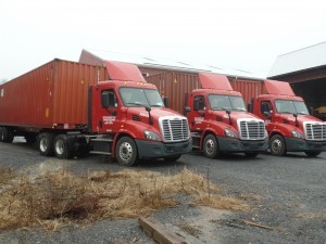 international sea containers lined up and ready to be loaded, Timberhaven Log Homes, log homes, log cabin homes, log cabins, post and beam homes, timberframe homes, timber frame homes, laminated logs, engineered logs, floor plan designs, kiln dried logs, international distribution