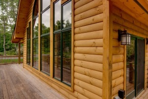beautiful trim corner with vast wall of glass on log home, Timberhaven Log Homes, log homes, log cabins, log cabin homes, laminated logs, kiln dried logs, engineered logs, kiln-dried laminated logs, post and beam home, timber frame, Pennsylvania