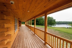 beautiful front porch with round railing, Timberhaven Log Homes, log homes, log cabins, log cabin homes, laminated logs, kiln dried logs, engineered logs, kiln-dried laminated logs, post and beam home, timber frame, Pennsylvania