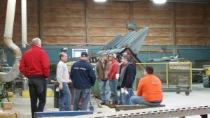 guests at builder's workshop seeing the planer at work, log home builders, Timberhaven Log Homes, log homes, log cabin homes, log cabins, post and beam homes, timberframe homes, timber frame homes, laminated logs, engineered logs, floor plan designs, kiln dried logs627_resized