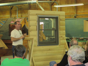 expert showing how to install a window in a log home, log home builders, Timberhaven Log Homes, log homes, log cabin homes, log cabins, post and beam homes, timberframe homes, timber frame homes, laminated logs, engineered logs, floor plan designs, kiln dried logs