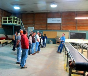 group of log home enthusiasts visiting Timberhaven Log Homes, log homes, log cabin homes, log cabins, post and beam homes, timberframe homes, timber frame homes, laminated logs, engineered logs, floor plan designs, kiln dried logs, nature friendly