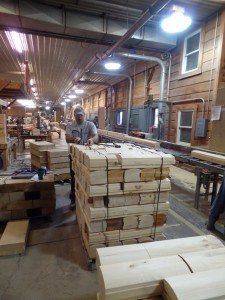 log ends being bundled for log home, Timberhaven Log Homes, log homes, log cabin homes, log cabins, post and beam homes, timberframe homes, timber frame homes, laminated logs, engineered logs, floor plan designs, kiln dried logs, nature friendly