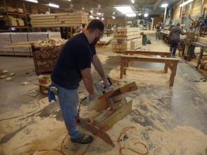 using chain saw to cut Dovetail corner, Timberhaven Log Homes, log homes, log cabin homes, log cabins, post and beam homes, timberframe homes, timber frame homes, laminated logs, engineered logs, floor plan designs, kiln dried logs, nature friendly