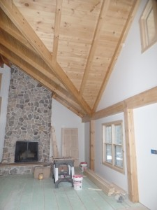 interior wall with drywall and fireplace, post and beam home, interior finishes, Timberhaven Log Homes, log homes, log cabin homes, log cabins, post and beam homes, timberframe homes, timber frame homes, laminated logs, engineered logs, floor plan designs, kiln dried logs