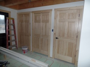 White Pine solid, raised-panel interior doors, post and beam home, interior finishes, Timberhaven Log Homes, log homes, log cabin homes, log cabins, post and beam homes, timberframe homes, timber frame homes, laminated logs, engineered logs, floor plan designs, kiln dried logs