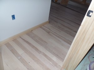 Hickory flooring in hallway, post and beam home, interior finishes, Timberhaven Log Homes, log homes, log cabin homes, log cabins, post and beam homes, timberframe homes, timber frame homes, laminated logs, engineered logs, floor plan designs, kiln dried logs