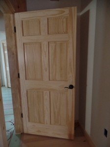 White Pine solid raised-panel interior doors, Schagle hardware in black, Timberhaven Log Homes, log homes, log cabin homes, log cabins, post and beam homes, timberframe homes, timber frame homes, laminated logs, engineered logs, floor plan designs, kiln dried logs
