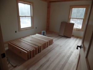 Hickory hardwood flooring in bedroom, post and beam home, interior finishes, Timberhaven Log Homes, log homes, log cabin homes, log cabins, post and beam homes, timberframe homes, timber frame homes, laminated logs, engineered logs, floor plan designs, kiln dried logs