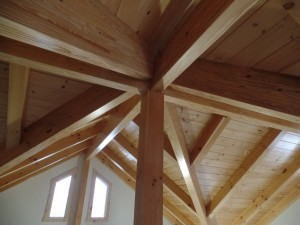 varied roof lines intersect at vertical post, post and beam home, interior finishes, Timberhaven Log Homes, log homes, log cabin homes, log cabins, post and beam homes, timberframe homes, timber frame homes, laminated logs, engineered logs, floor plan designs, kiln dried logs