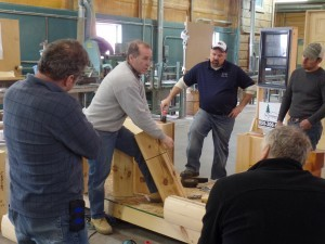 expert demonstrating log home construction practices, log home builders, Timberhaven Log Homes, log homes, log cabin homes, log cabins, post and beam homes, timberframe homes, timber frame homes, laminated logs, engineered logs, floor plan designs, kiln dried logs