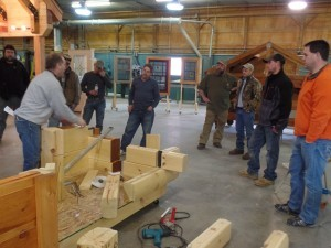 crew seeing how to build a log home, log home builders, Timberhaven Log Homes, log homes, log cabin homes, log cabins, post and beam homes, timberframe homes, timber frame homes, laminated logs, engineered logs, floor plan designs, kiln dried logs