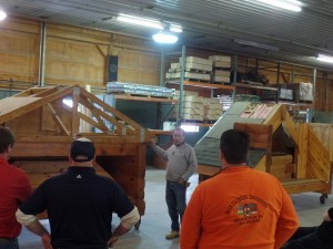 expert demonstrating roof system construction, log home builders, Timberhaven Log Homes, log homes, log cabin homes, log cabins, post and beam homes, timberframe homes, timber frame homes, laminated logs, engineered logs, floor plan designs, kiln dried logs