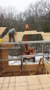 builders stacking gable end logs, two story log home construction, solid log gables, Timberhaven Log Homes, log homes, log cabin homes, log cabins, post and beam homes, timberframe homes, timber frame homes, laminated logs, engineered logs, floor plan designs, kiln dried logs, Flury Builders, Joe Walsh, Timberhaven local reps, log homes in Massachusetts, log homes in Rhode Island, MA, RI, log home builders