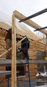 building shed porch on log home, outdoor living area, Timberhaven Log Homes, log homes, log cabin homes, log cabins, post and beam homes, timberframe homes, timber frame homes, laminated logs, engineered logs, floor plan designs, kiln dried logs, Flury Builders, Joe Walsh, Timberhaven local reps, log homes in Massachusetts, log homes in Rhode Island, MA, RI, log home builders