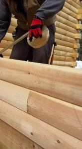 builder applying Butylog to tongue of log, solid log breezeway, Log Homes, log homes, log cabin homes, log cabins, post and beam homes, timberframe homes, timber frame homes, laminated logs, engineered logs, floor plan designs, kiln dried logs, Flury Builders, Joe Walsh, Timberhaven local reps, log homes in Massachusetts, log homes in Rhode Island, MA, RI, log home builders, solid log breezeway