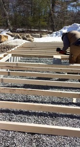 builder assembling stick-frame garage wall on the ground, two-car garage, Timberhaven Log Homes, log homes, log cabin homes, log cabins, post and beam homes, timberframe homes, timber frame homes, laminated logs, engineered logs, floor plan designs, kiln dried logs, Flury Builders, Joe Walsh, Timberhaven local reps, log homes in Massachusetts, log homes in Rhode Island, MA, RI, log home builders