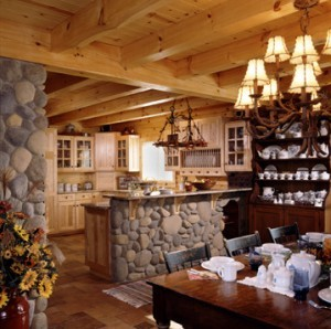 open kitchen and dining area of log home with exposed heavy timbers, log home flooring, Timberhaven Log Homes, log homes, log cabin homes, log cabins, post and beam homes, timberframe homes, timber frame homes, laminated logs, engineered logs, floor plan designs, kiln dried logs, Flury Builders, Joe Walsh, Timberhaven local reps, log homes in Massachusetts, log homes in Rhode Island, MA, RI, log home builders