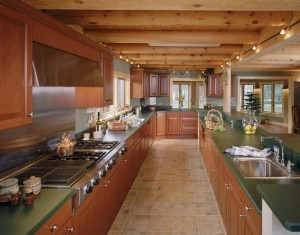 galley kitchen with exposed round heavy timbers, log home flooring, Timberhaven Log Homes, log homes, log cabin homes, log cabins, post and beam homes, timberframe homes, timber frame homes, laminated logs, engineered logs, floor plan designs, kiln dried logs, Flury Builders, Joe Walsh, Timberhaven local reps, log homes in Massachusetts, log homes in Rhode Island, MA, RI, log home builders