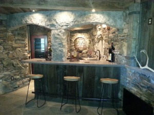 stone and reclaimed wood used on finished in basement of log home, Timberhaven Log Homes, log homes, log cabin homes, log cabins, post and beam homes, timberframe homes, timber frame homes, laminated logs, engineered logs, floor plan designs, kiln dried logs, Timberhaven local reps, log home builders, interior wall coverings, log homes in PA
