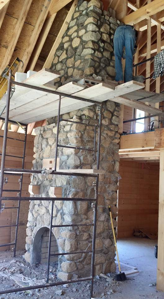 Stone Fireplace In Center Of Great Room Full Masonry Timberhaven Log Homes