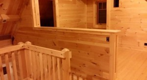 half wall by stairs completed with tongue and groove, Timberhaven Log Homes, log homes, log cabin homes, log cabins, post and beam homes, timberframe homes, timber frame homes, laminated logs, engineered logs, floor plan designs, kiln dried logs, Timberhaven local reps, log home builders, interior wall coverings, log homes in PA
