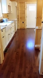 hardwood flooring installed in main living areas, Log home kitchen, Timberhaven Log Homes, log homes, log cabin homes, log cabins, post and beam homes, timberframe homes, timber frame homes, laminated logs, engineered logs, floor plan designs, kiln dried logs, Timberhaven local reps, log homes in PA, log home builders