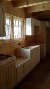 white cabinets partiually installed in log home, Log home kitchen, Timberhaven Log Homes, log homes, log cabin homes, log cabins, post and beam homes, timberframe homes, timber frame homes, laminated logs, engineered logs, floor plan designs, kiln dried logs, Timberhaven local reps, log homes in PA, log home builders