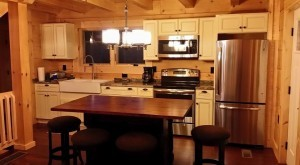complete kitchen in newly constructed log home, Log home kitchen, Timberhaven Log Homes, log homes, log cabin homes, log cabins, post and beam homes, timberframe homes, timber frame homes, laminated logs, engineered logs, floor plan designs, kiln dried logs, Timberhaven local reps, log homes in PA, log home builders