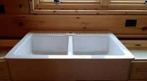 white farmhouse sink installation, Log home kitchen, Timberhaven Log Homes, log homes, log cabin homes, log cabins, post and beam homes, timberframe homes, timber frame homes, laminated logs, engineered logs, floor plan designs, kiln dried logs, Timberhaven local reps, log homes in PA, log home builders