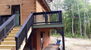 black railing on deck and stairs, exterior finishes, Log home kitchens, Timberhaven Log Homes, log homes, log cabin homes, log cabins, post and beam homes, timberframe homes, timber frame homes, laminated logs, engineered logs, floor plan designs, kiln dried logs, Timberhaven local reps, log homes in PA, log home builders