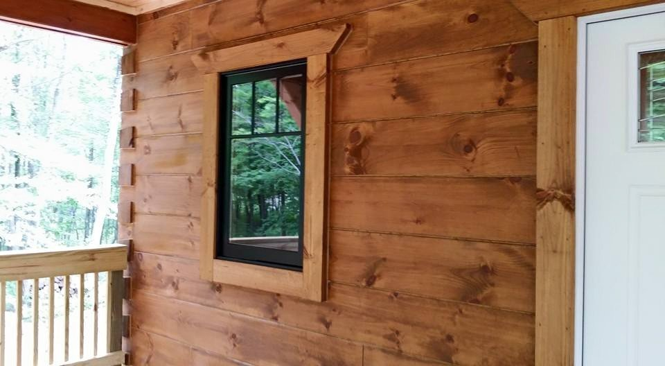 Under construction protect your log home investment for Log cabin window trim