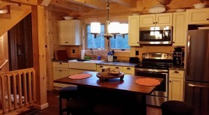 galley kitchen in finished log home, white kitchen cabinetry, custom kitchen cabinets, ultimate home, ultimate log home, Log home kitchens, Timberhaven Log Homes, log homes, log cabin homes, log cabins, post and beam homes, timberframe homes, timber frame homes, laminated logs, engineered logs, floor plan designs, kiln dried logs, Timberhaven local reps, log homes in PA, log home builders