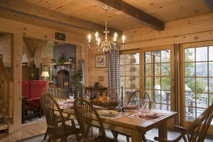 wide open dining room area with view out sliding glass doors, Warm Thanksgiving wishes, Log home kitchens, Timberhaven Log Homes, log homes, log cabin homes, log cabins, post and beam homes, timberframe homes, timber frame homes, laminated logs, engineered logs, floor plan designs, kiln dried logs, Timberhaven local reps, log homes in PA, log home builders, give thanks, thank you