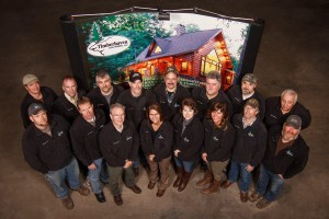 group of employees standing by sign, merry christmas, log homes, log cabin homes, log cabins, post and beam homes, timberframe homes, timber frame homes, laminated logs, engineered logs, floor plan designs, kiln dried logs, Timberhaven local reps, log homes in Pennsylvania, log homes in PA, Timberhaven Log Homes, Timberhaven Log & Timber Homes